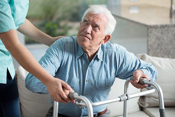 Disabled senior man being in nursing home